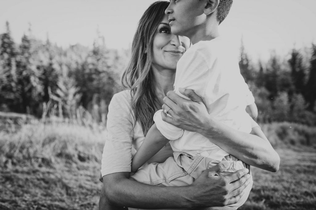 A picture of a mom holding her son during their Edmonton family photography session