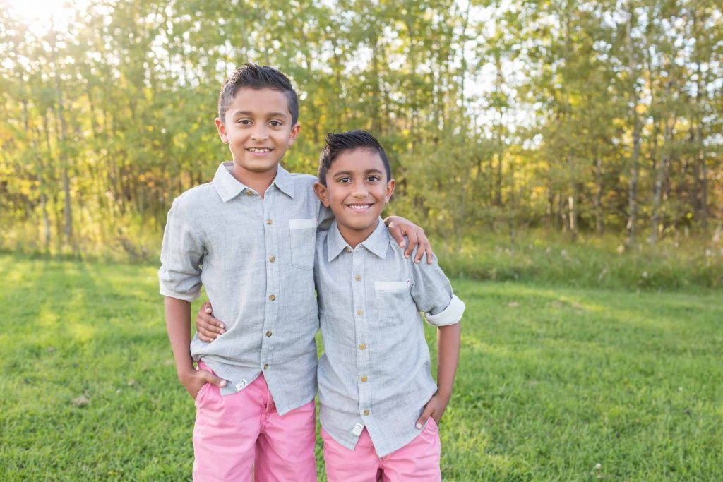 Brothers hugging each other during their family pictures