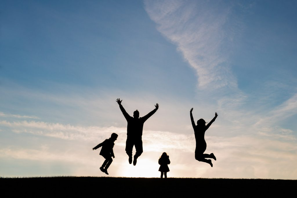 A Portfolio Image Of A Family Jumping From Edmonton family photographers Sunny & Jess