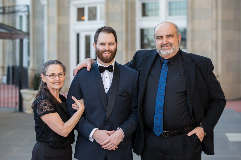 Photo of groom with his parents