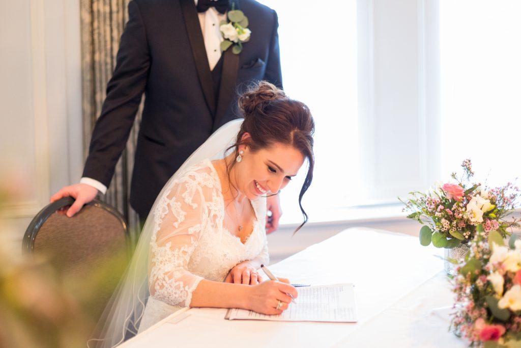 Bride signing the wedding registry