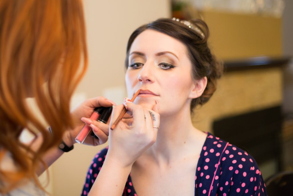 Edmonton bride getting makeup done