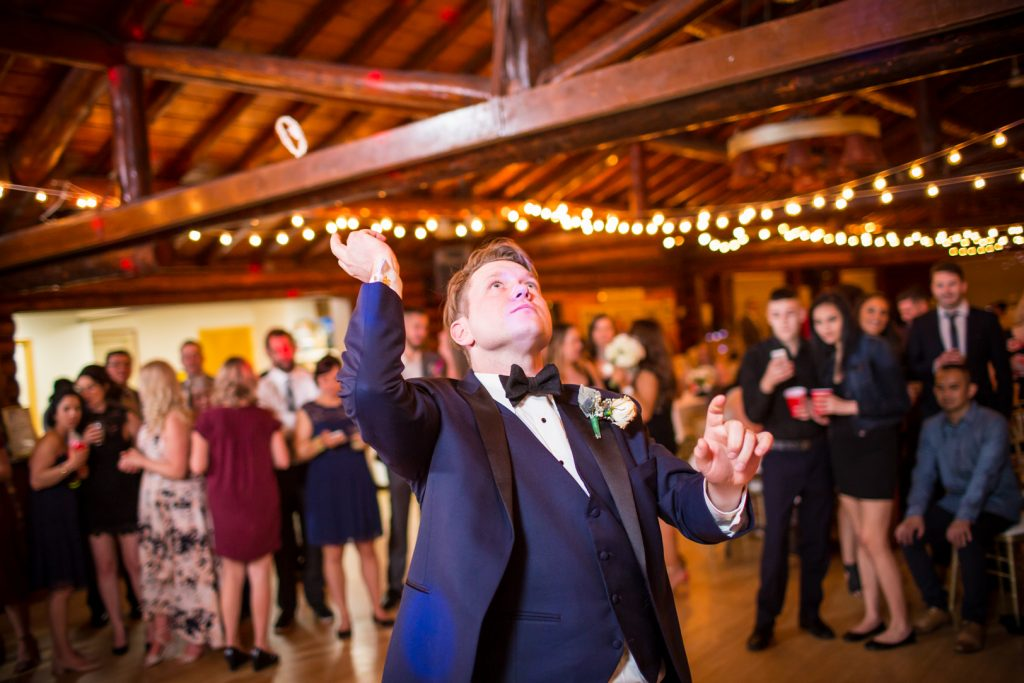 Groom throwing the garter