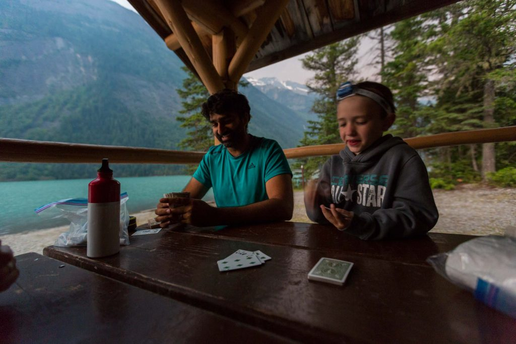 backpacking with kids playing cards at night