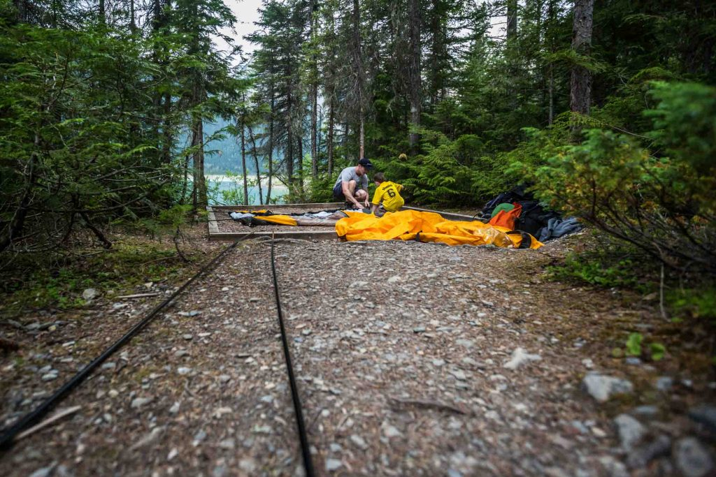setting up a tent after backpacking
