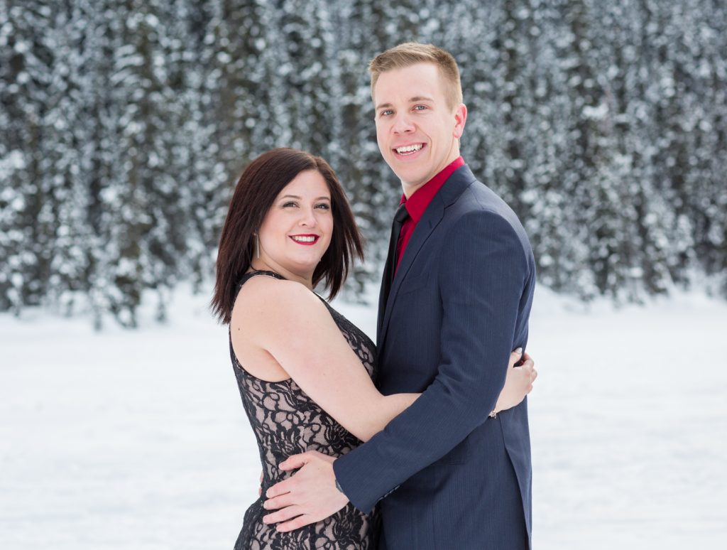 Couple standing for formal engagement photos - Mountain Engagement Photography by Deep Blue Photography