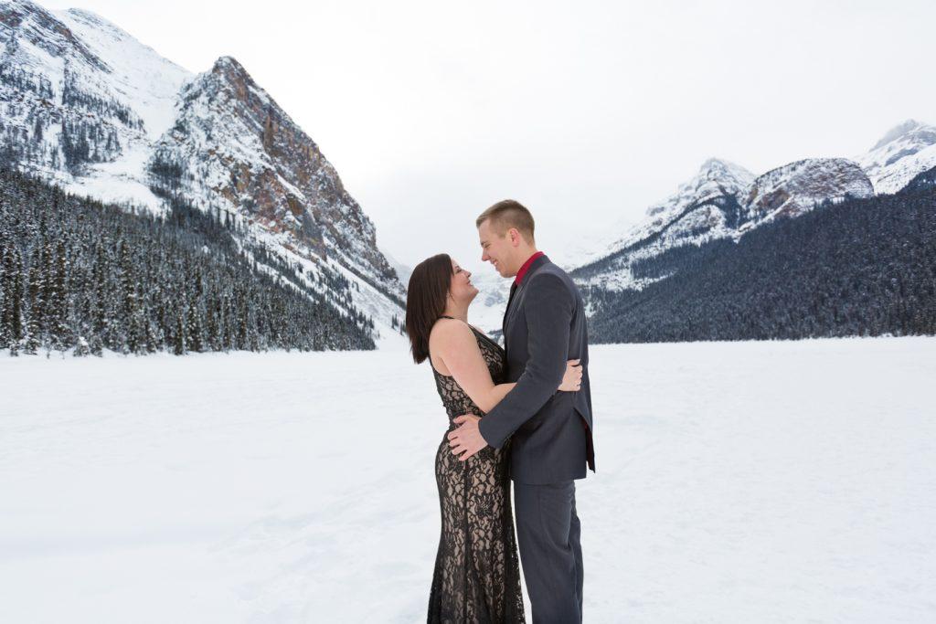 Mountain engagement photos at Lake Louise - Mountain Engagement Photography by Deep Blue Photography