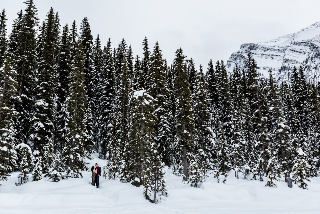 Epic landscape winter engagement photos at Lake Louise - Mountain Engagement Photography by Deep Blue Photography