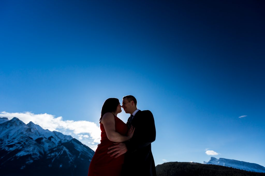 Couple with bright blue mountain sky - Mountain Engagement Photography by Deep Blue Photography
