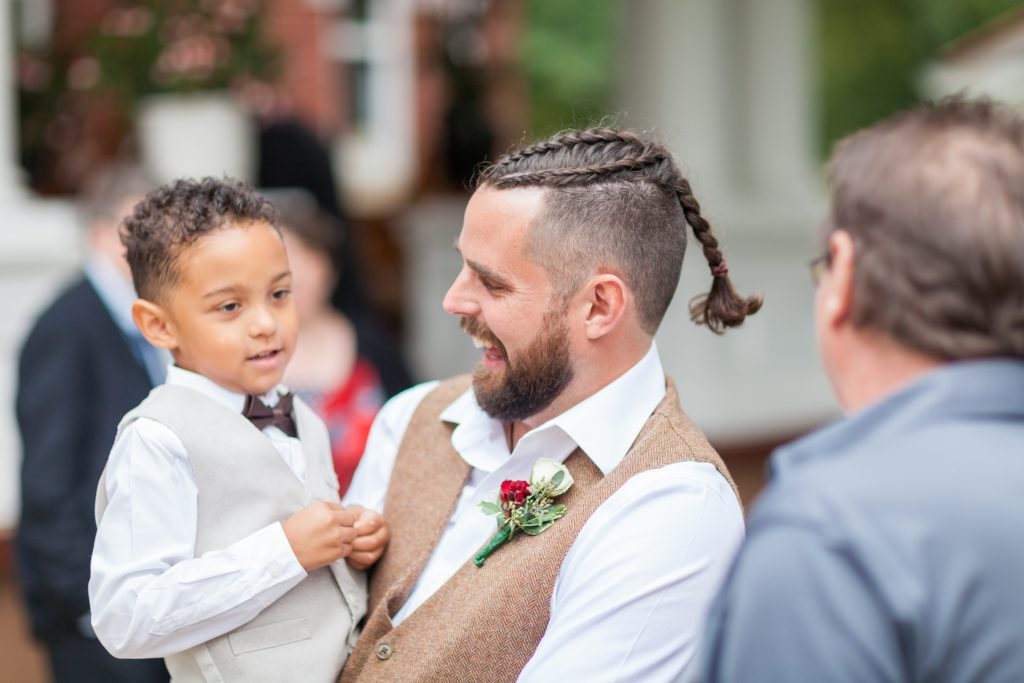 Groom long hair mohawk at wedding