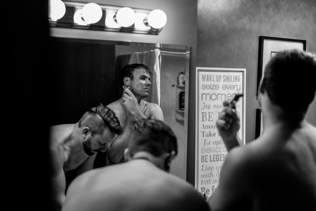 groomsmen getting ready and shaving