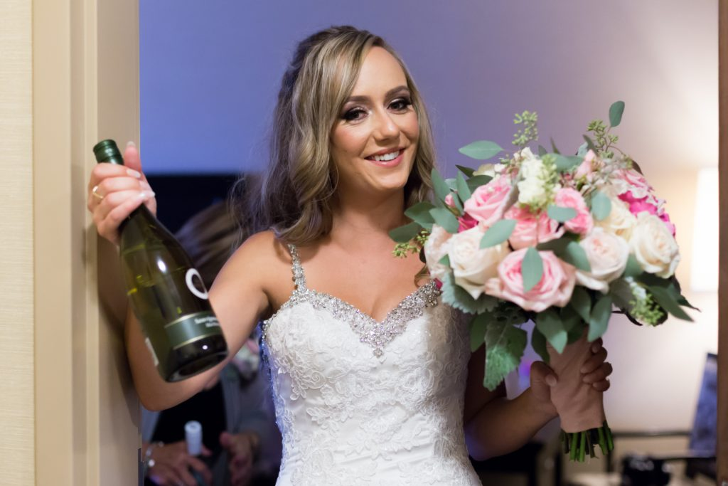 bride with a bottle of champagne