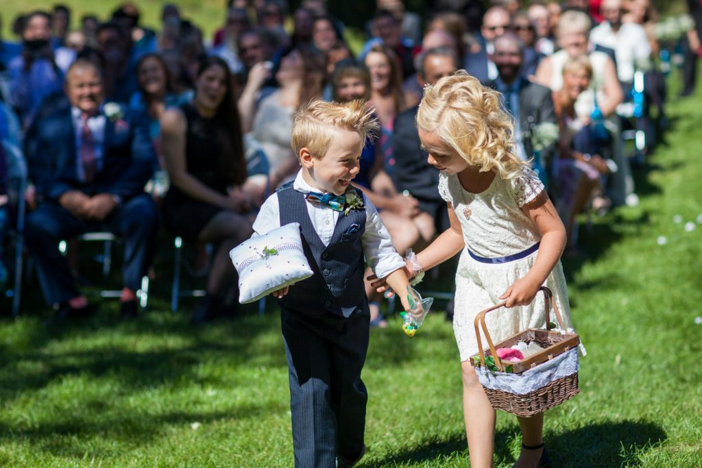 photo of flower girl and ring bearer walking down the aisle