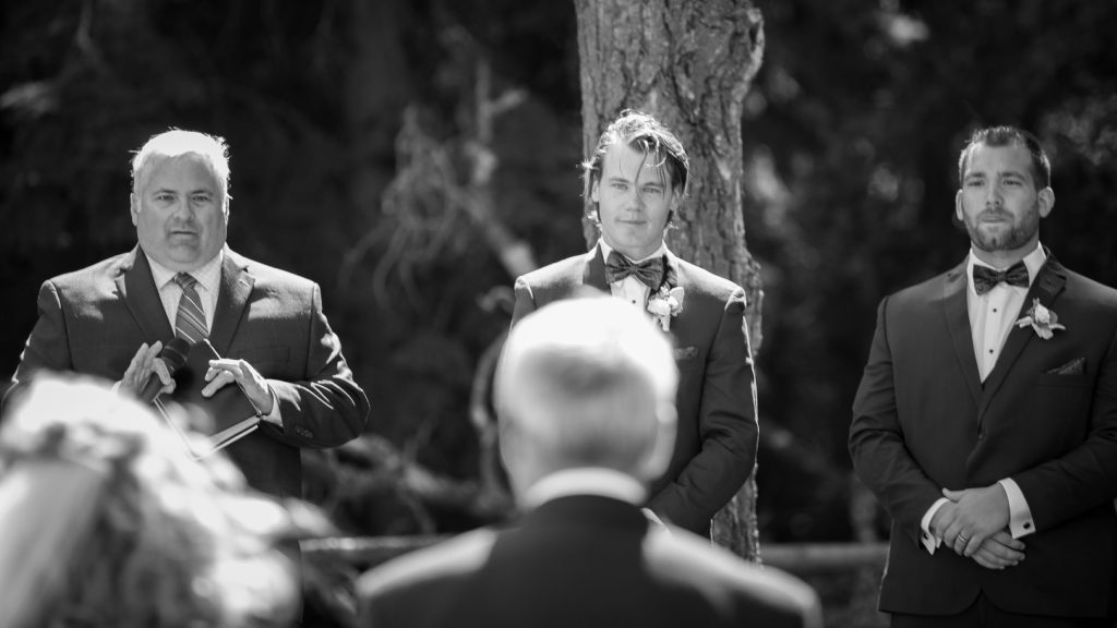 Grooms first look at the bride during outdoor wedding ceremony