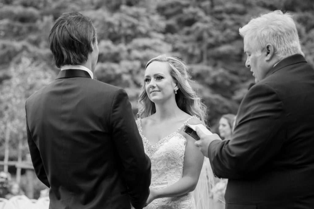 photo of bride looking at her groom during the wedding ceremony