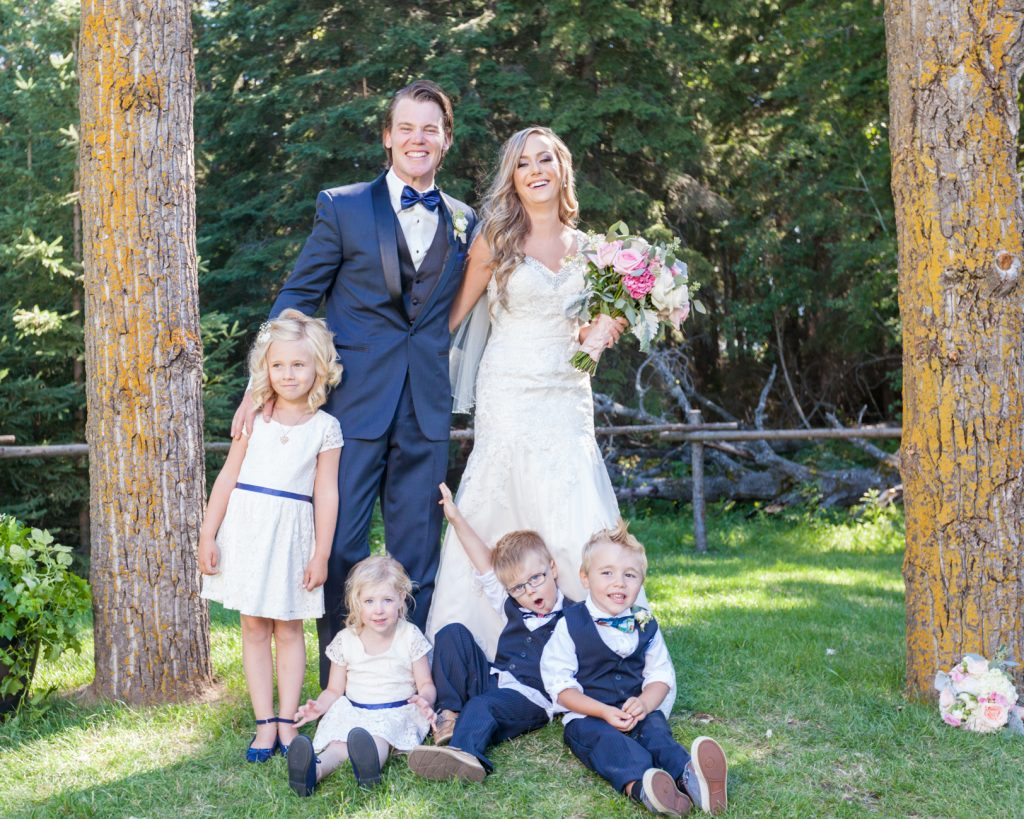 portrait of bride and groom with their flower girls and ring bearer