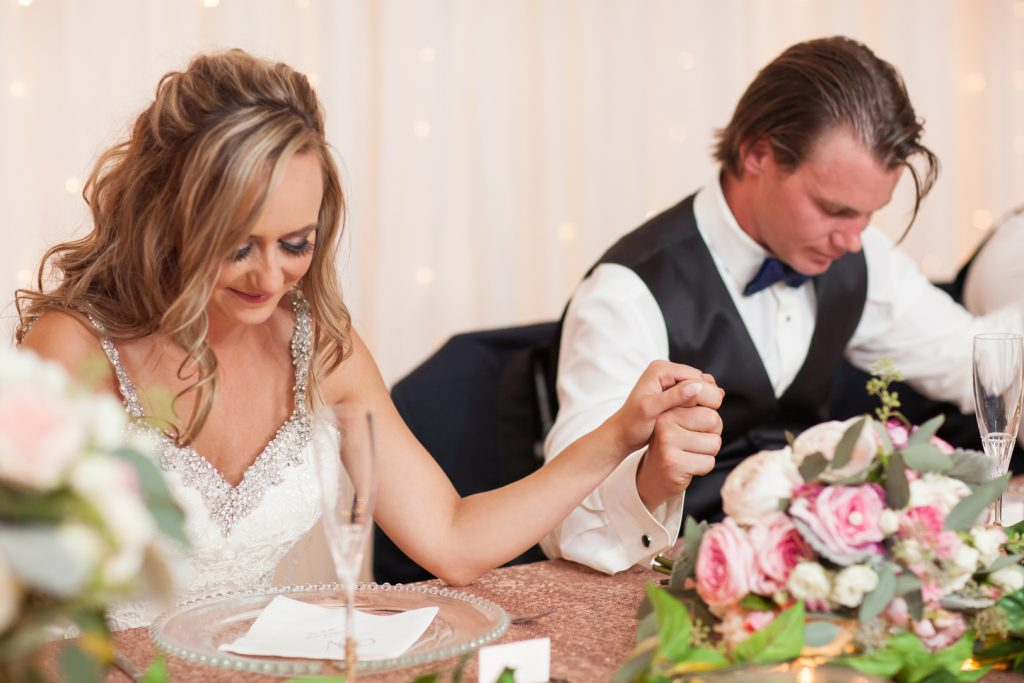 Photo of bride and groom during their wedding reception
