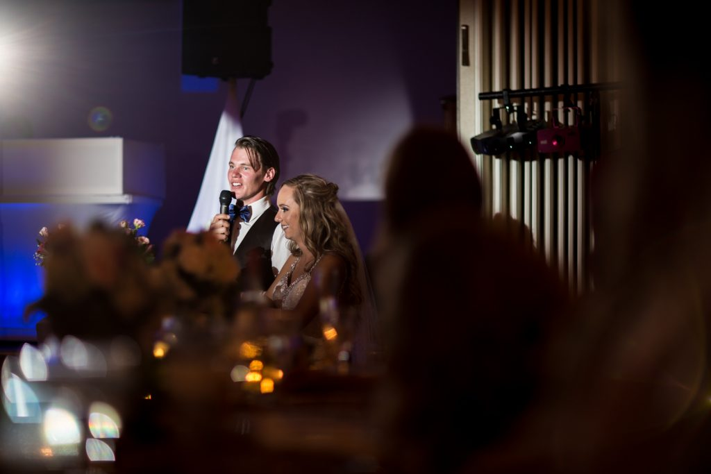bride and groom giving their thank you speech during reception
