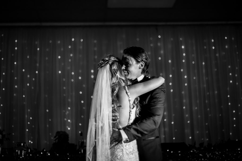 romantic first dance at country wedding reception