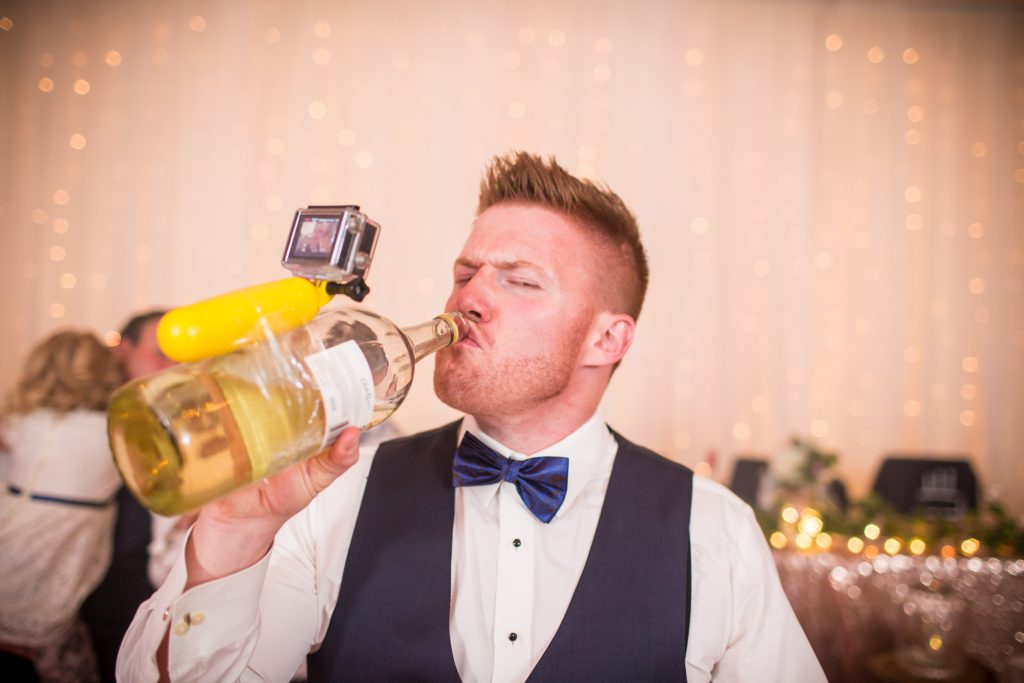 Wedding party with go pro camera on tequila bottle