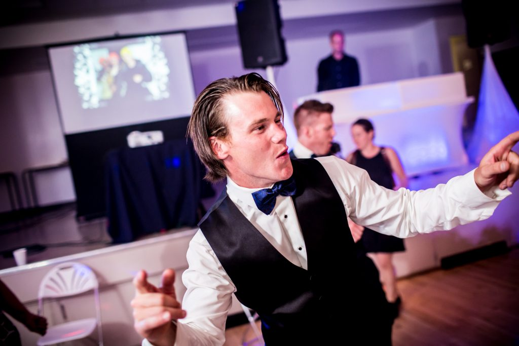 Groom dancing during country wedding reception