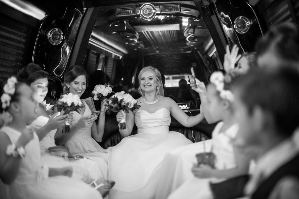 Bride and bridesmaids take a limo to the wedding ceremony