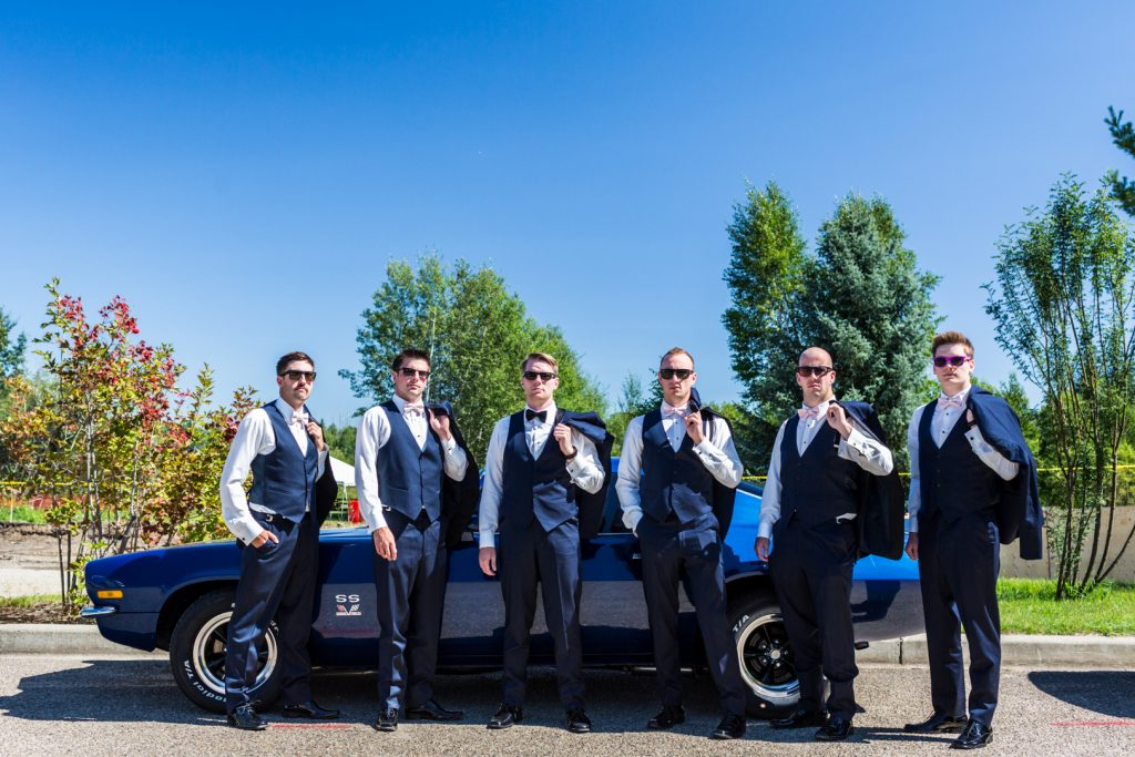 Groomsmen pre wedding photo with muscle car