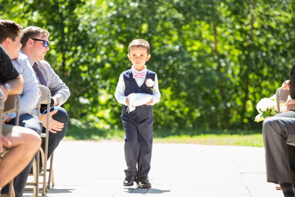 Ring bearer at outdoor wedding ceremony