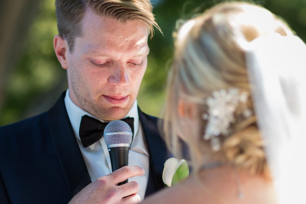 Groom reading his wedding vows