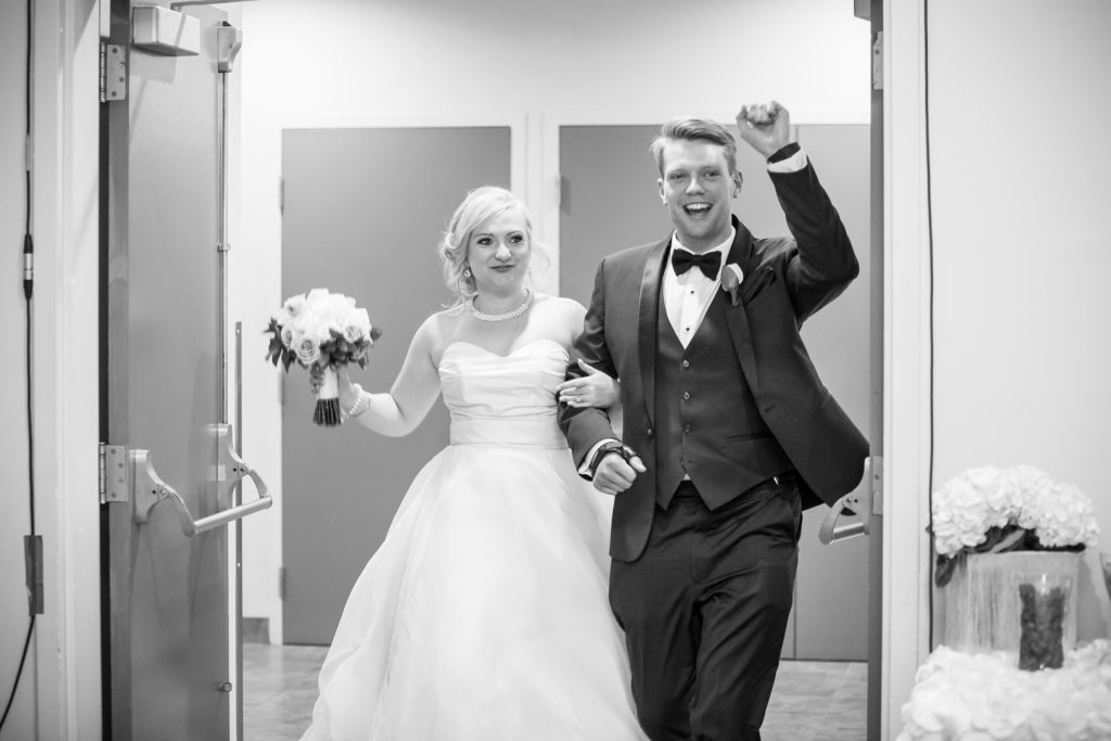 Bride and groom making their reception entrance