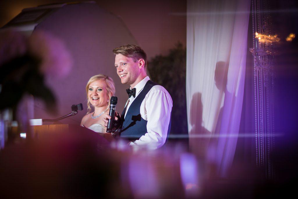 Pink and purple wedding reception uplighting