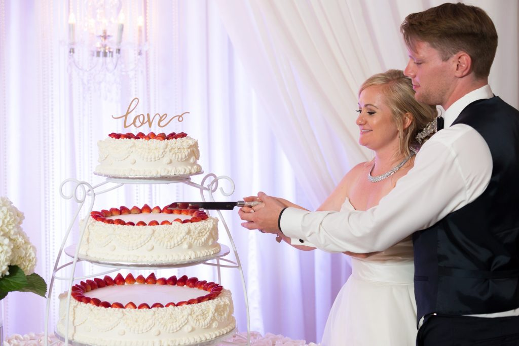 Three tiered strawberry wedding cake