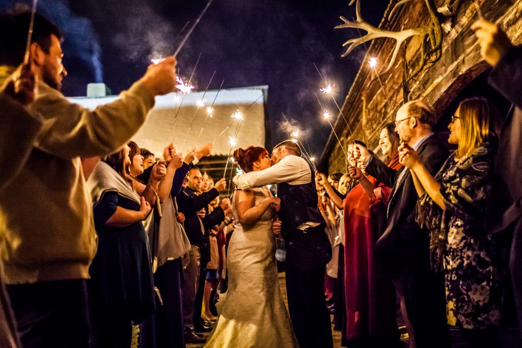 Winter wedding sparkler exit