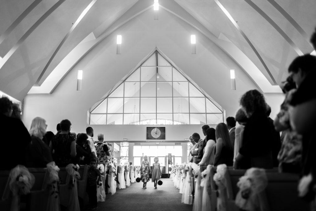 Bride walking down the aisle at St Thomas More Church