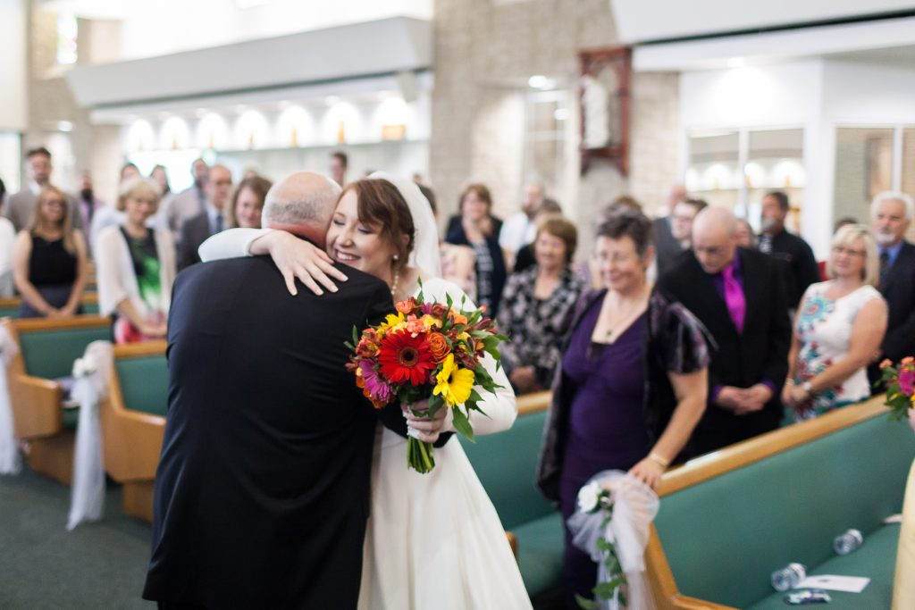 It was an emotional moment when the father of the bride walked his daughter up the aisle at St Thomas More Church