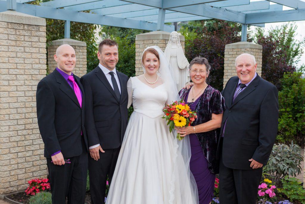 Family wedding portraits taken at St Thomas More Church