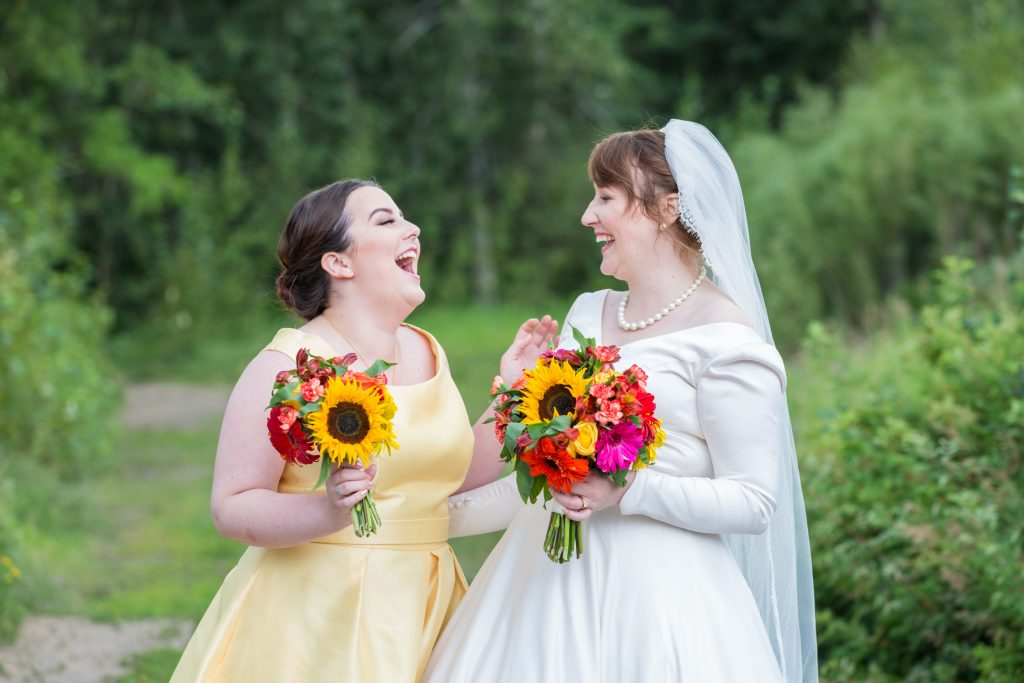 Photo of the bride and her bridesmaid at McTaggart Sanctuary in Edmonton