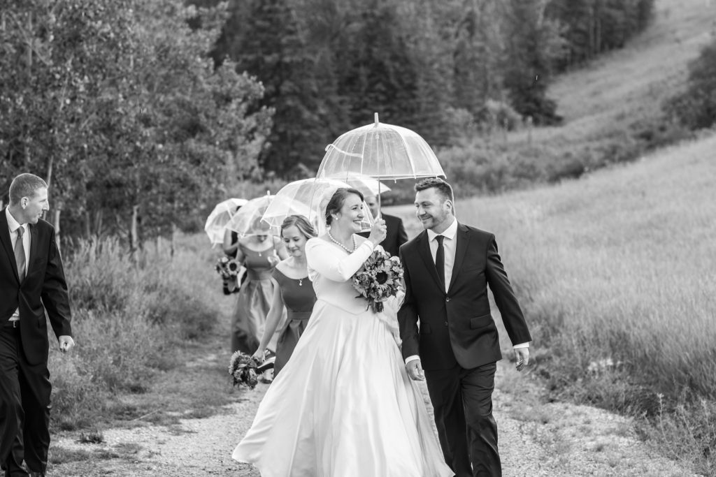 Wedding photos in the rain after St Thomas More Church wedding service