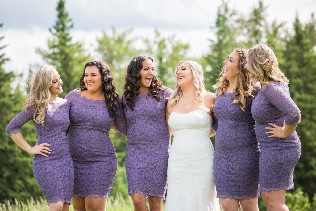 Bride hanging out with her bridesmaid during their photo session at Snow Valley