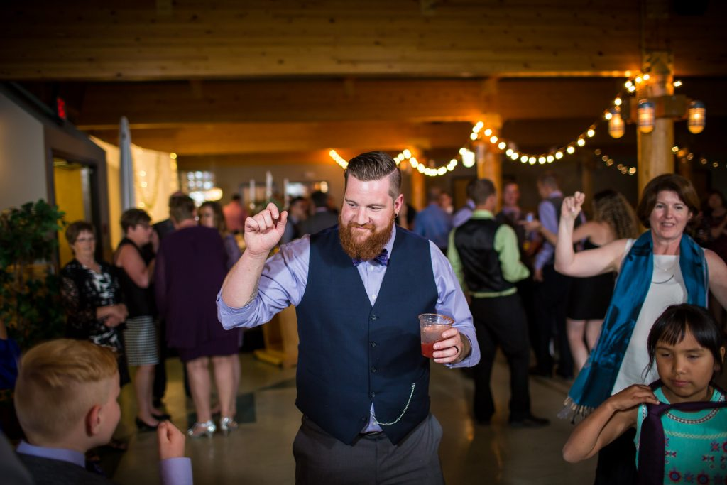 Guests dancing during Snow Valley wedding reception party