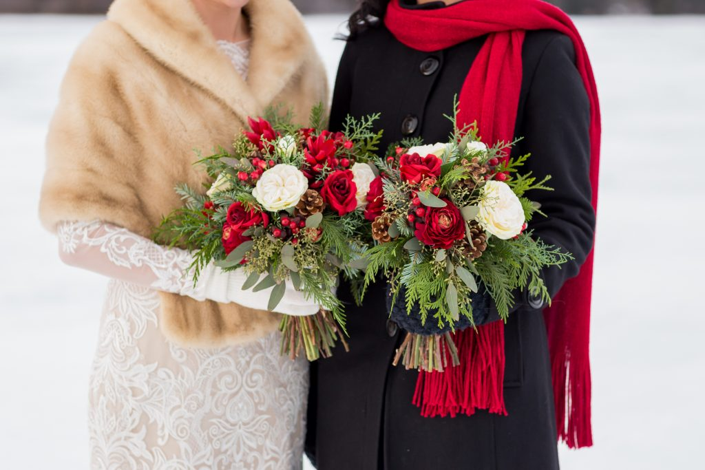 Red and white wedding bouquets for an outdoor winter wedding at Pyramid Lake