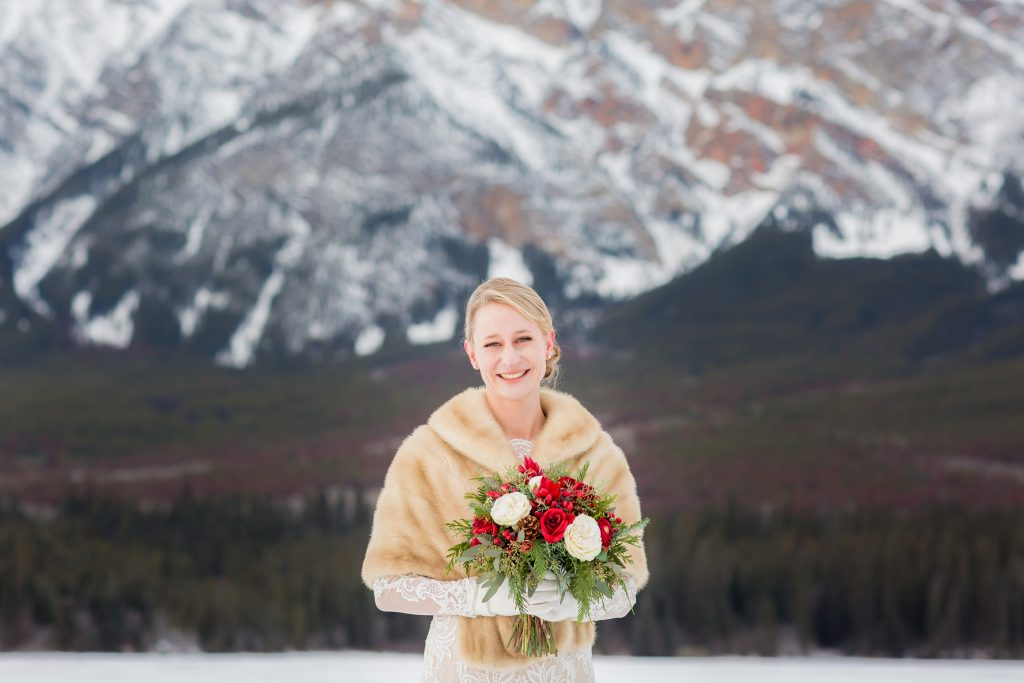 Bride wearing a beautiful mink coat for her outdoor wedding ceremony at Pyramid Lake