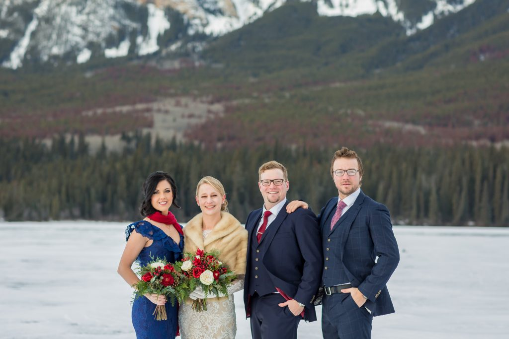 Navy and red wedding colours are perfect for this outdoor winter wedding in Jasper at Pyramid Lake lodge