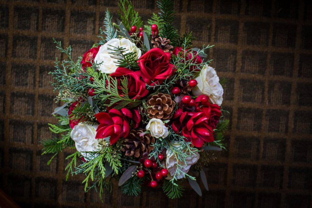 Red and white bouquet for Jasper winter wedding at Pyramid Lake