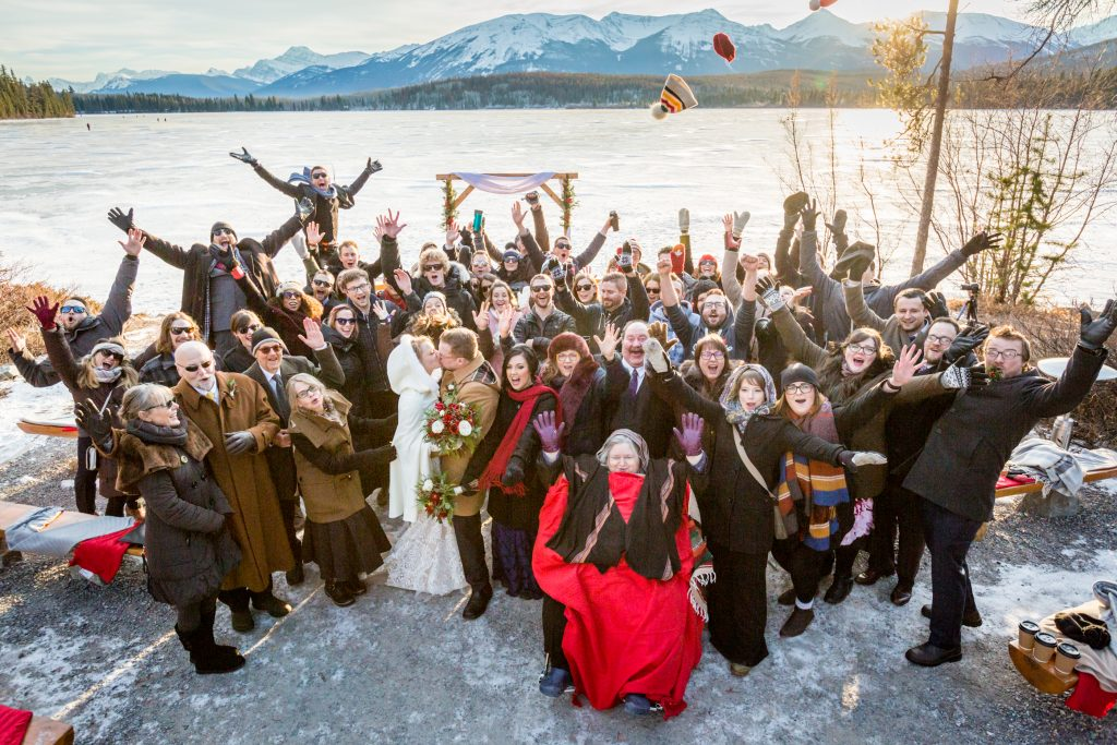 Group photo of bride and groom with all of their guests after their winter wedding ceremony at Pyramid Lake