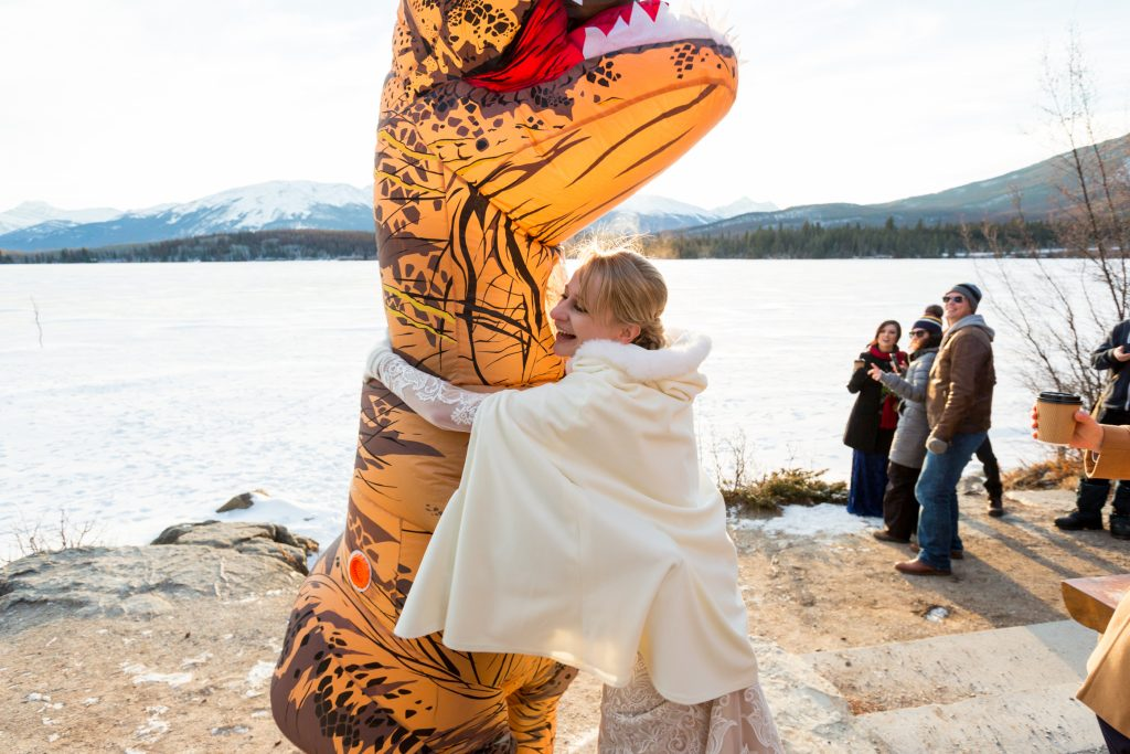 Inflatable t-rex suit at wedding ceremony in Jasper