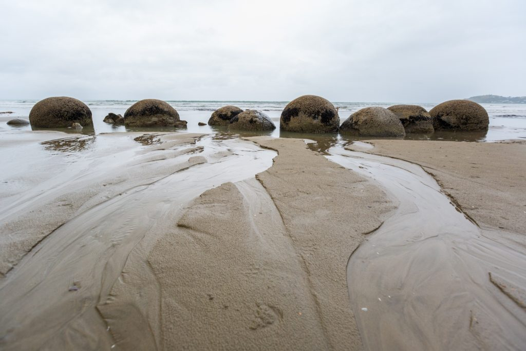 Driving From Christchurch to Dunedin to Curio Bay stopping to see the Moeraki boulders