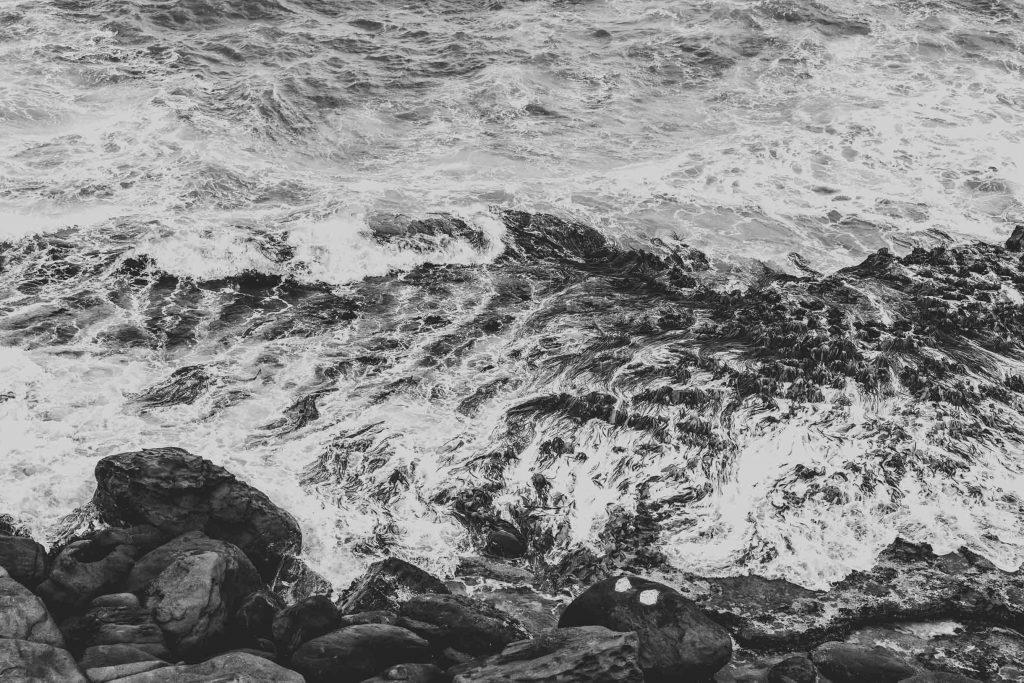 curio bay views water rocks