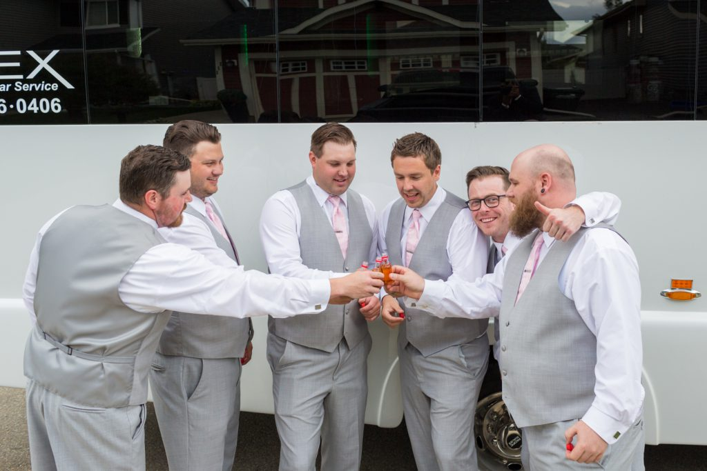 Groomsmen having a drink before the wedding
