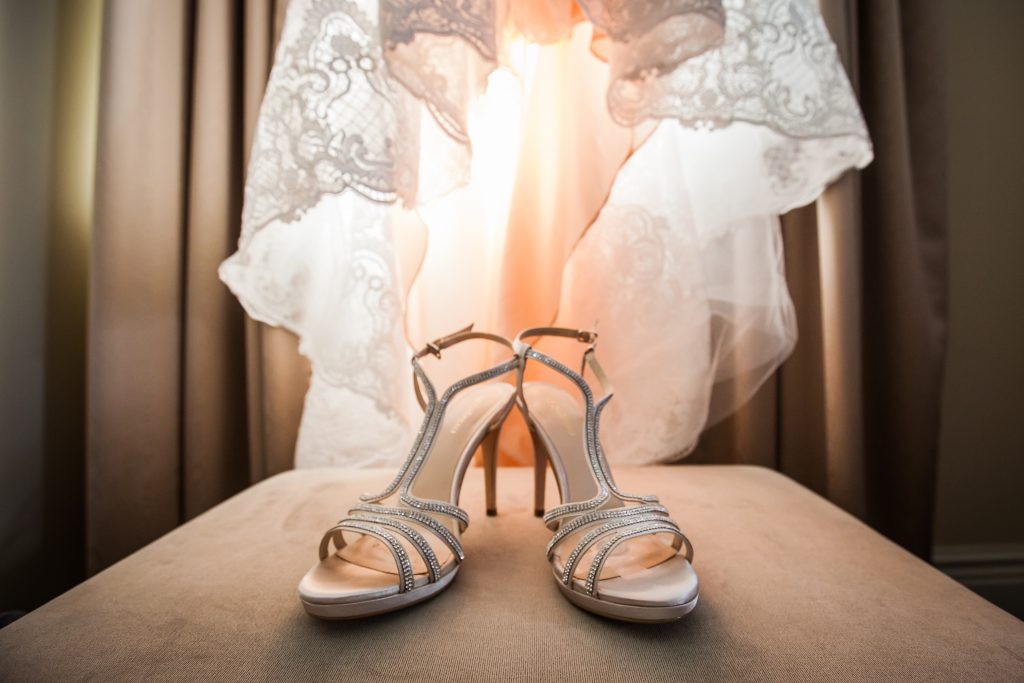 Photo of the brides gold wedding shoes